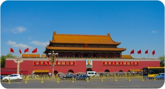 Various culturally important buildings dot the edge of the square, including - most famously - the Forbidden City. Here is Tian'anmen Monument, the gateway to the Forbidden City. A portrait of Mao Zedong is hung at the gate.